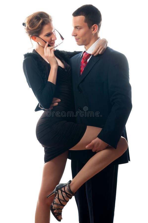 Señora atractiva hermosa que seduce al hombre de negocios joven imagenes de archivo