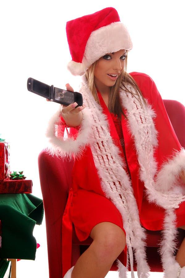 Señora atractiva Santa Cellphone fotos de archivo