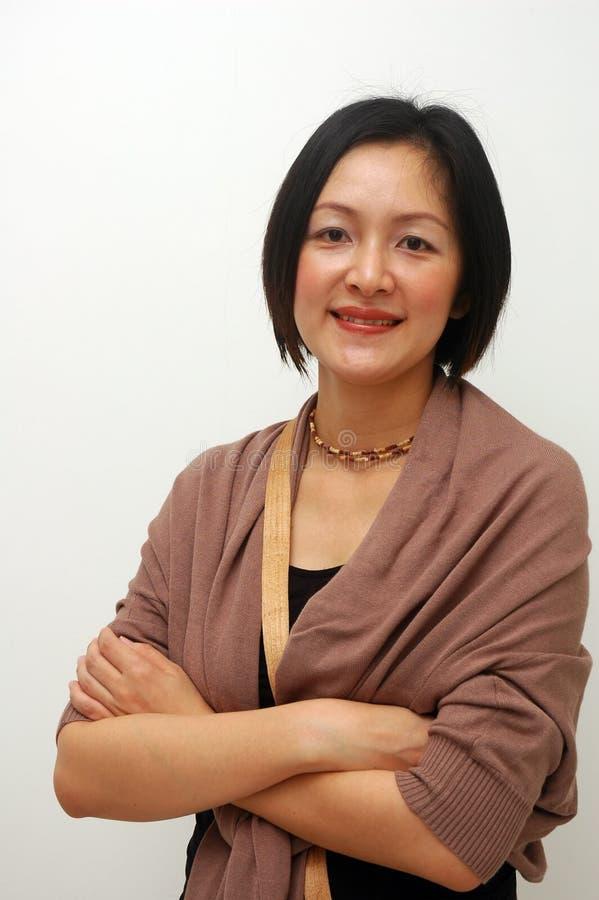 Señora china alegre fotos de archivo