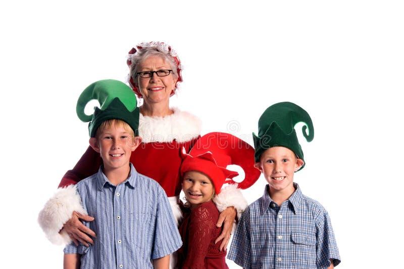 Señora Claus y ayudantes fotografía de archivo libre de regalías