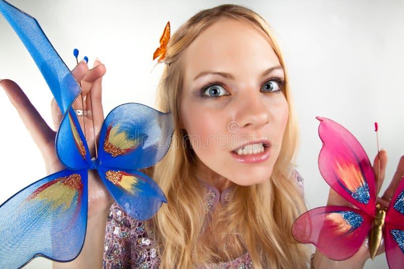 Señora con los butterflyes fotografía de archivo libre de regalías