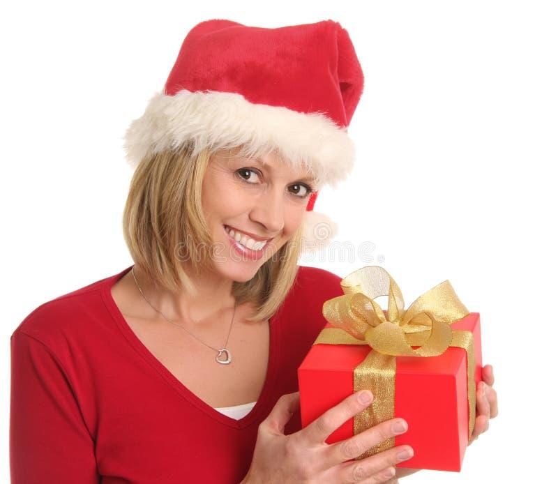 Señora de la Navidad y un regalo imagen de archivo