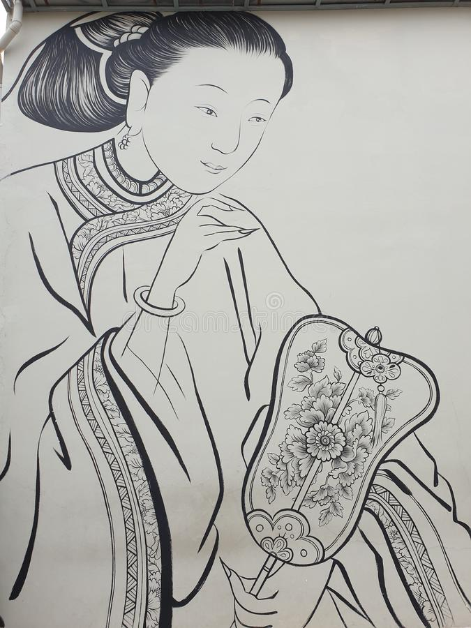 Señora de Oriental que hace una fan imagen de archivo