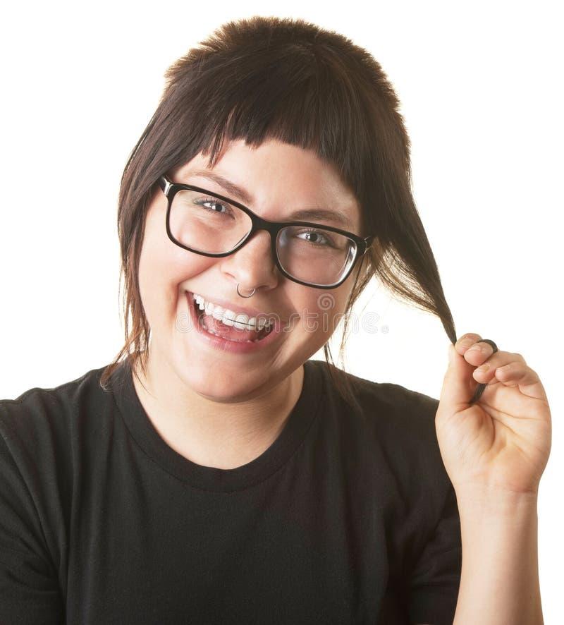Señora de risa Playing con el pelo foto de archivo