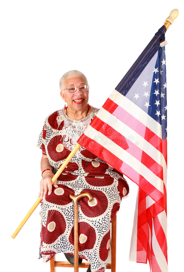 Señora del afroamericano que sostiene el indicador americano fotos de archivo