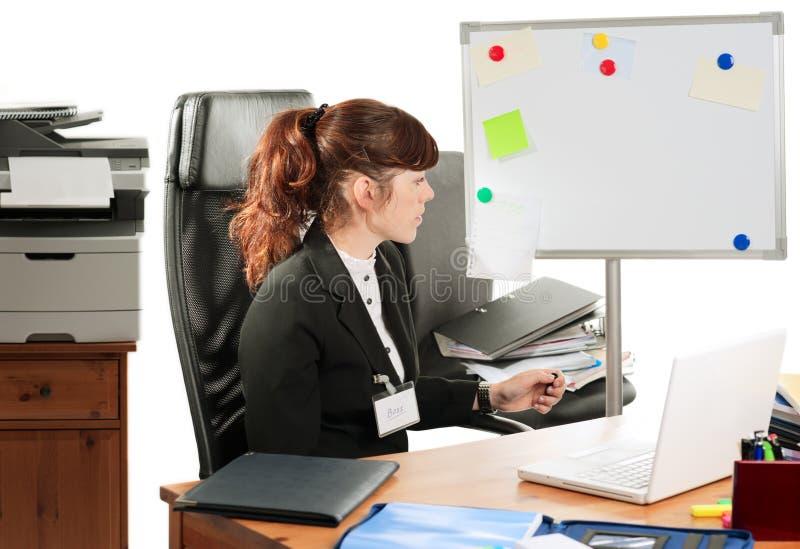 Señora del asunto en un escritorio fotos de archivo libres de regalías