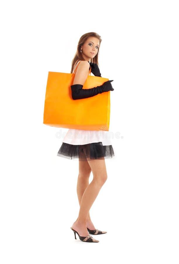Señora elegante con el panier anaranjado imágenes de archivo libres de regalías