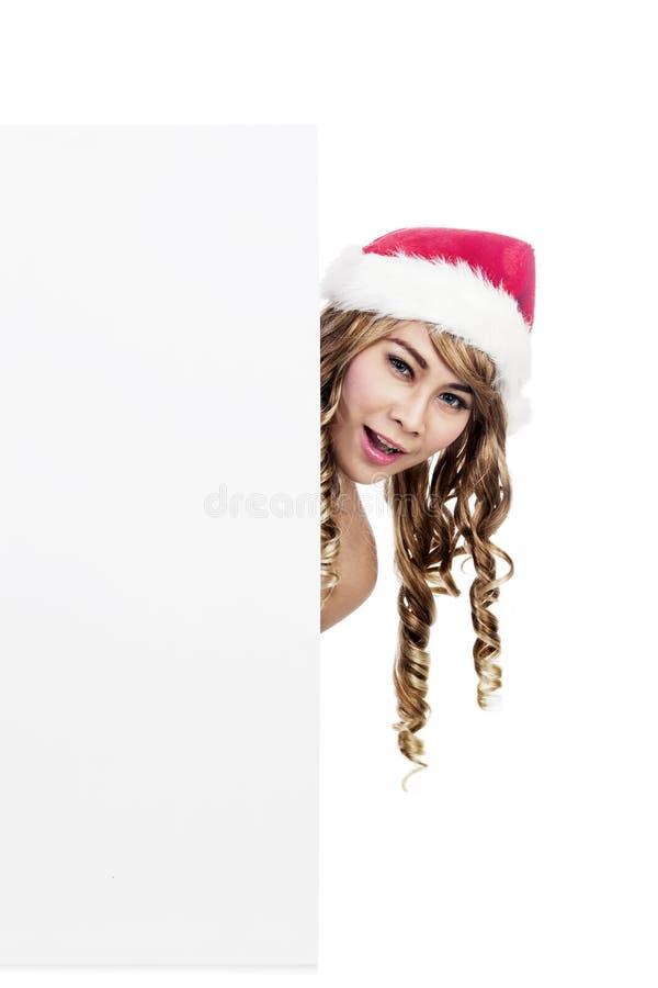 Señora en blanco Papá Noel de la muestra aislado en blanco imagen de archivo