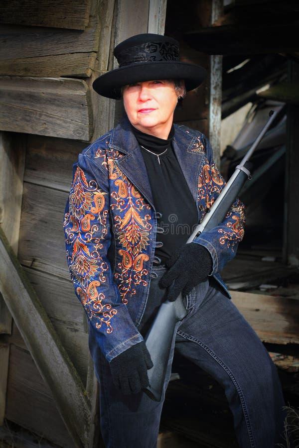 Señora Gunslinger imagenes de archivo