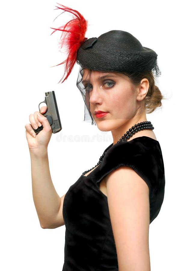 Señora hermosa con el arma imagen de archivo libre de regalías