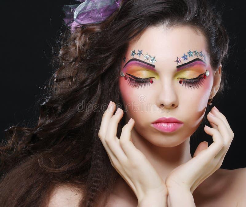 Señora hermosa con maquillaje artístico foto de archivo