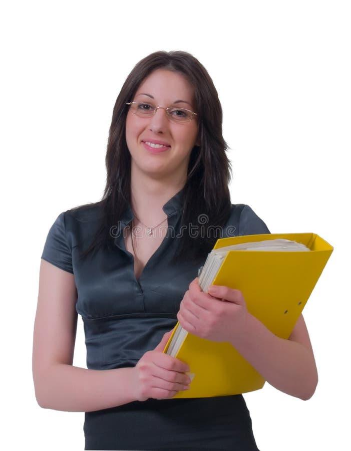 Señora joven alegre del asunto con una carpeta fotografía de archivo