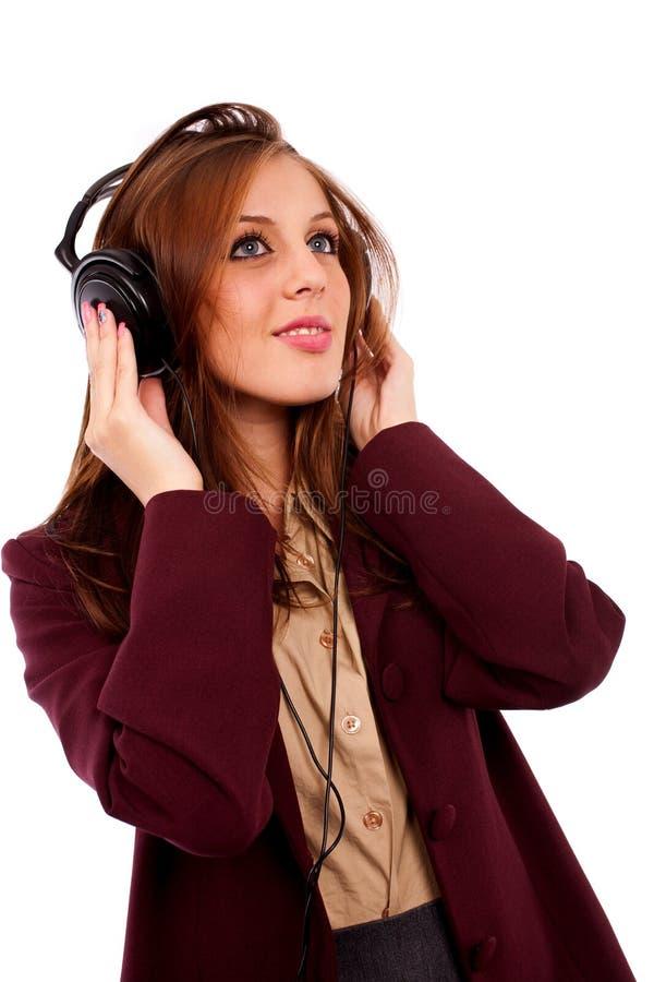 Señora joven del asunto con los auriculares foto de archivo libre de regalías