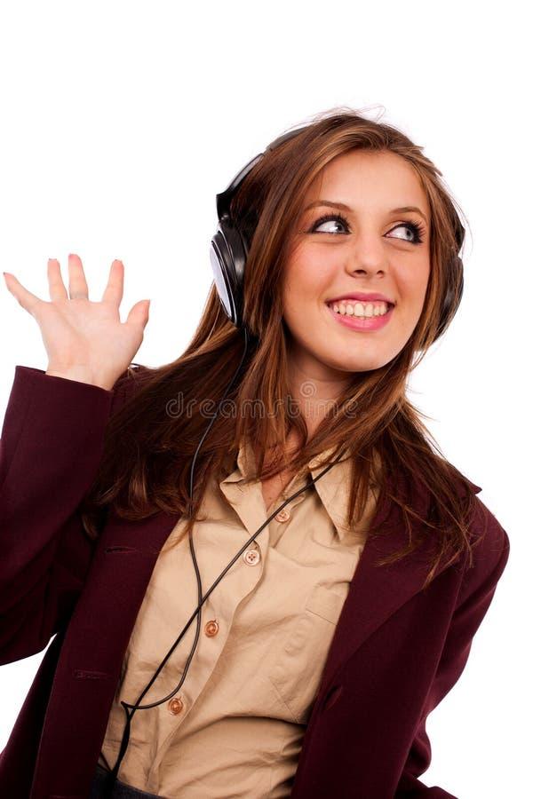 Señora joven del asunto con los auriculares fotografía de archivo
