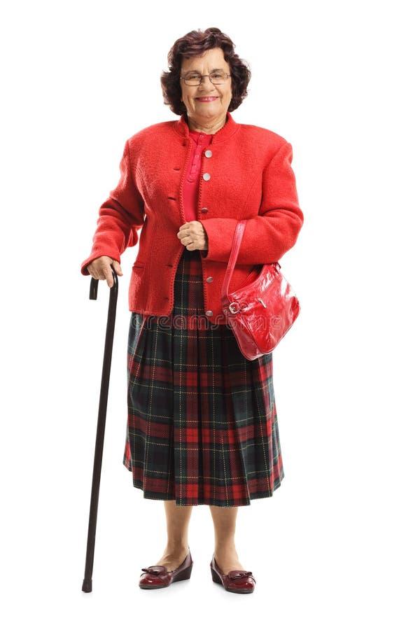 Señora mayor en un traje rojo fotografía de archivo