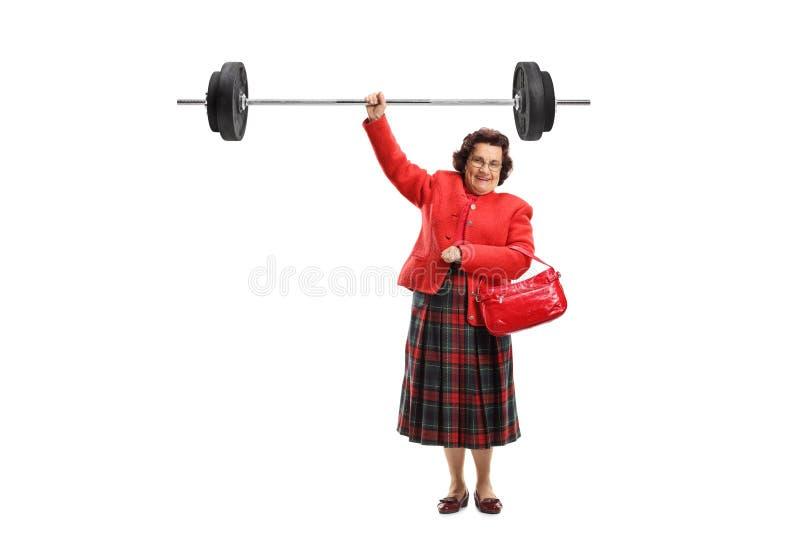 Señora mayor que levanta un barbell con una mano imágenes de archivo libres de regalías