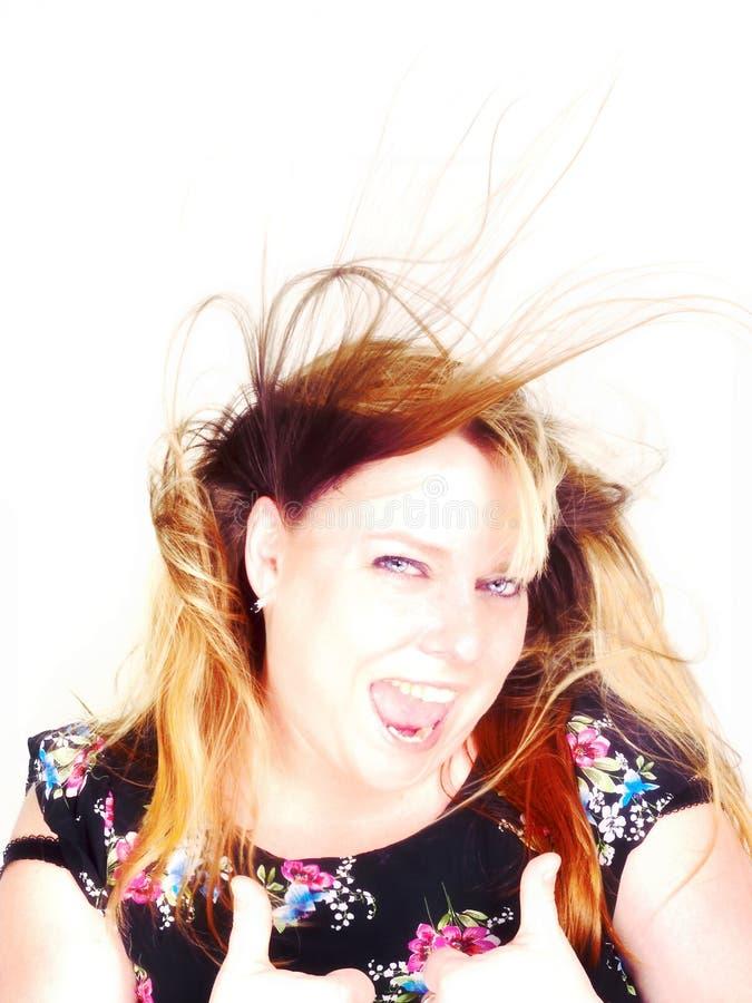 Señora muy azotada por el viento fotos de archivo