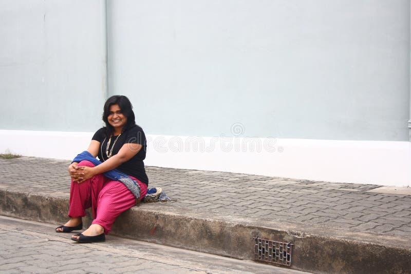 Señora obesa feliz Relaxing After Morning Walk imagen de archivo
