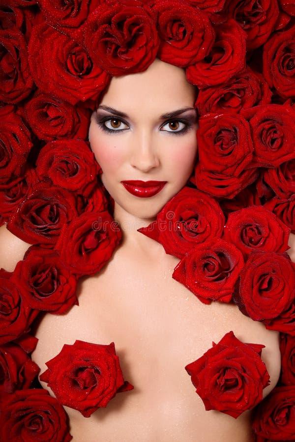 Señora roja de las rosas imagen de archivo