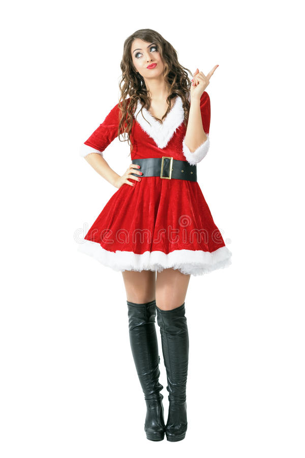 Señora seria Santa Claus que regaña el finger que mira para arriba foto de archivo