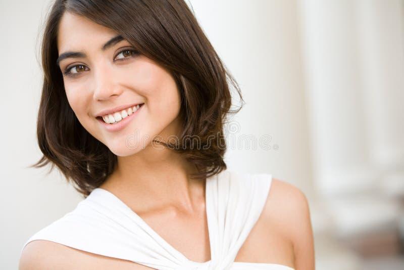 Señora sonriente imagenes de archivo