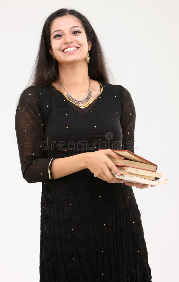 Señora sonriente con los libros fotos de archivo libres de regalías