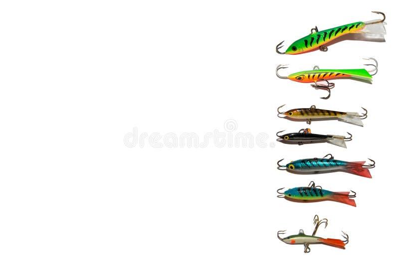 Señuelos de la pesca del invierno Balanceadores de la pesca En el fondo blanco foto de archivo
