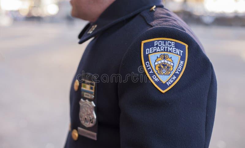 Se dell'ufficiale di polizia a Macy sfoggiano immagini stock