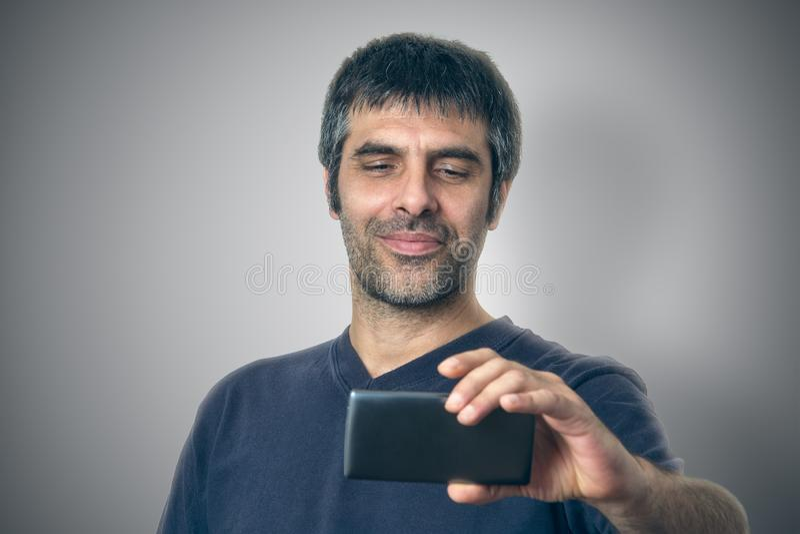Se telefonen fotografering för bildbyråer