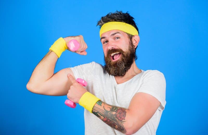 Se volete essere forte Tipo motivato dell'atleta Retro attrezzatura dello sportivo che prepara fondo blu Unisca la mia classe di  fotografia stock libera da diritti