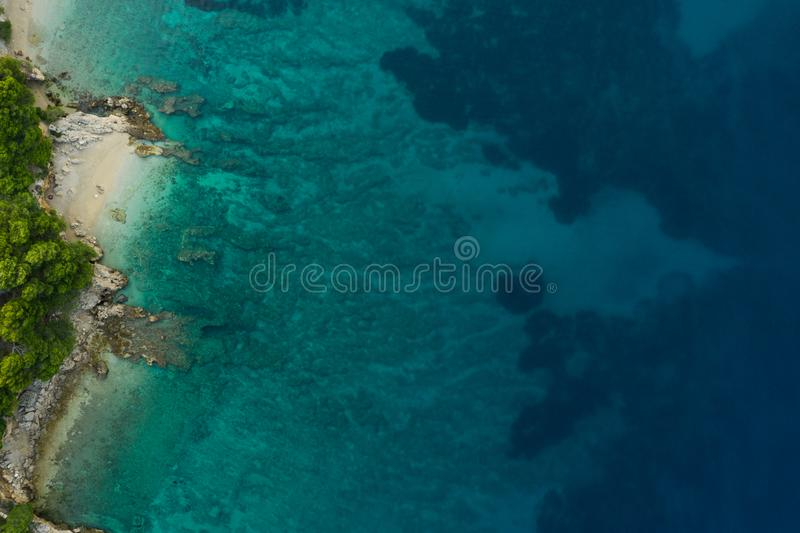 Sea aerial view, top view, amazing nature background.The color of the water and beautifully bright. Azure beach with rocky stock photos