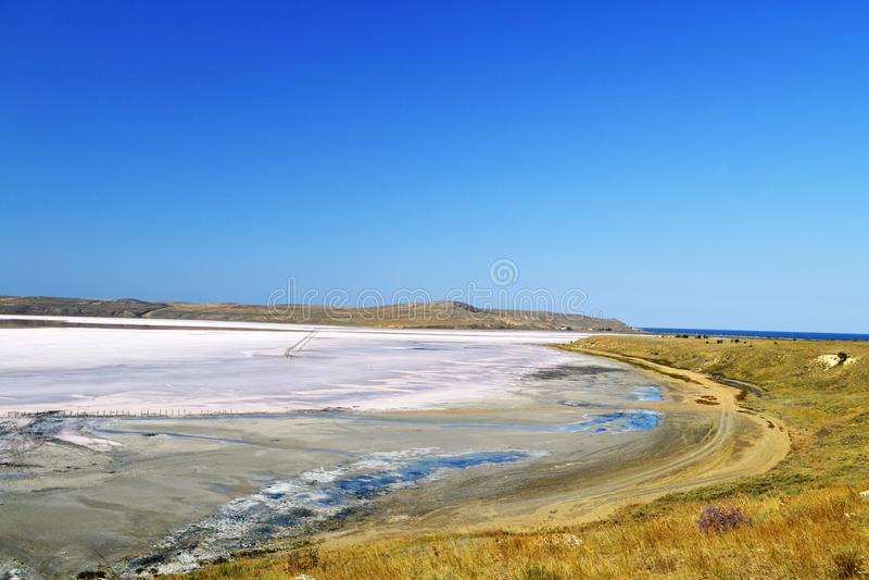 The sea of Azov. Summer shore of the sea of Azov. Romantic stay. Beautiful planet Earth. Unique salt lake Chokrak royalty free stock photography