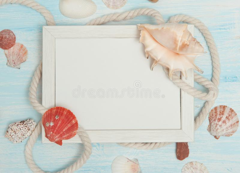 Sea background with frame and blue painted wood, rope, starfish, shells royalty free stock photography