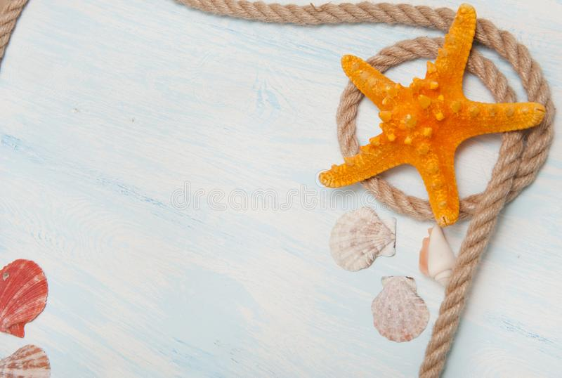 Sea background with blue wood, rope, starfish, shells stock photography