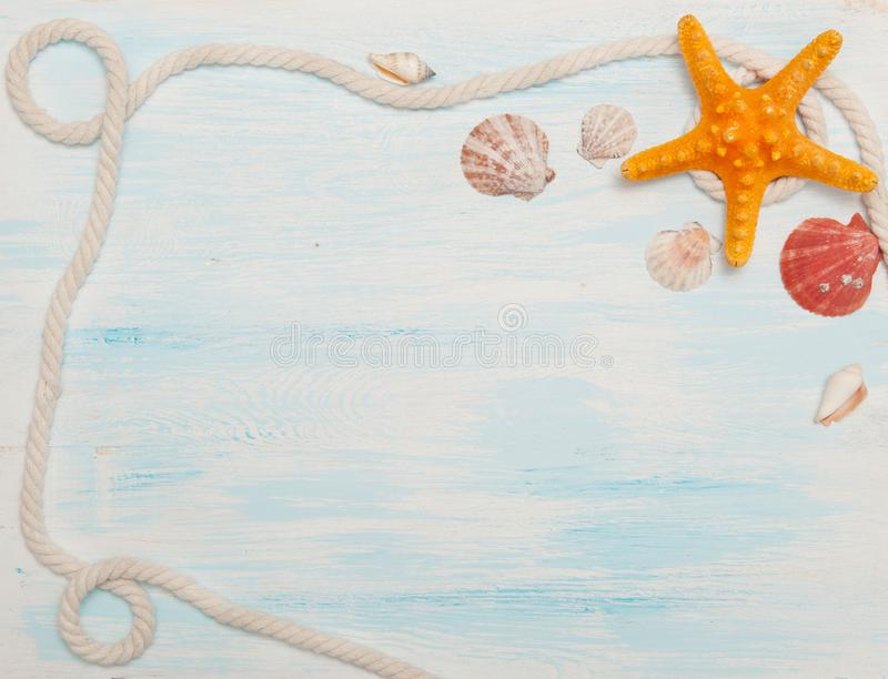 Sea background with blue wood, rope, starfish, shells stock photo
