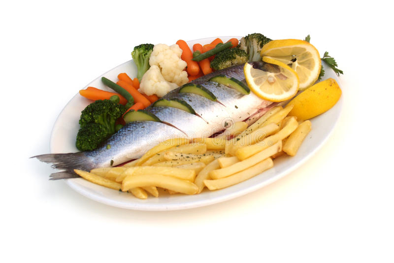 Sea bass. Oven cooked sea bass with mixed vegetable royalty free stock photos