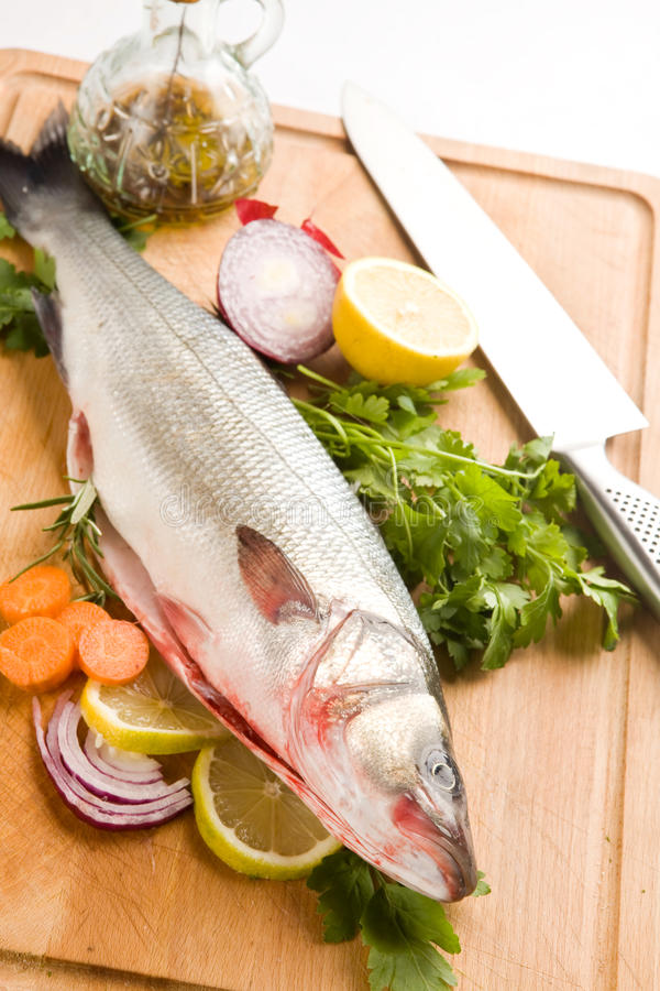 Sea Bass. Photo of sea bass on a wood chopping board royalty free stock photography
