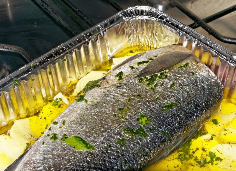 Sea bass. Good sea bass and potatoes stock images