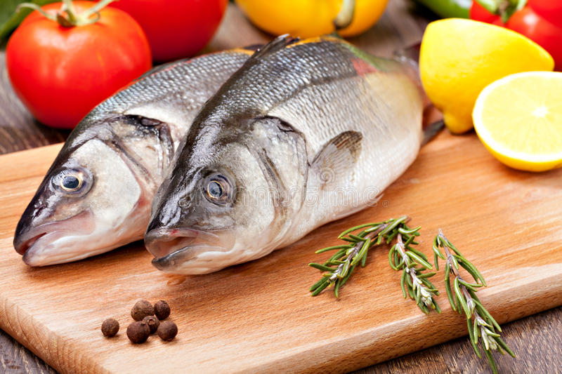 Sea Bass. With the vegetables and lemon stock images