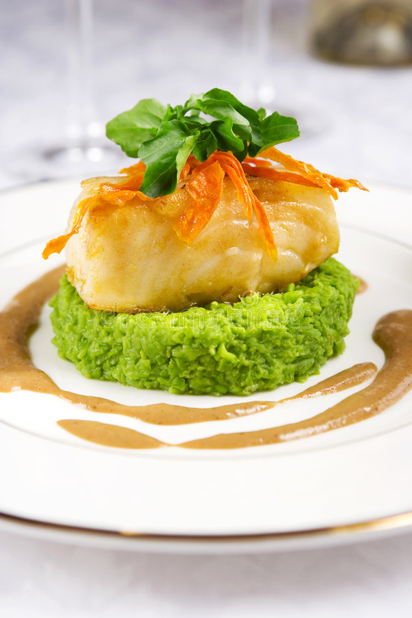 Sea bass. Served with mashed pea and mushroom sauce stock photo
