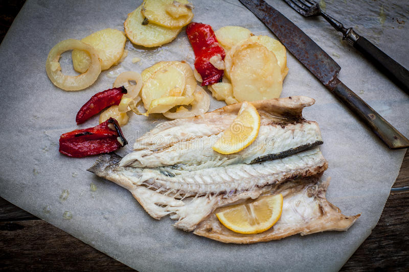 Sea bass baked royalty free stock photo