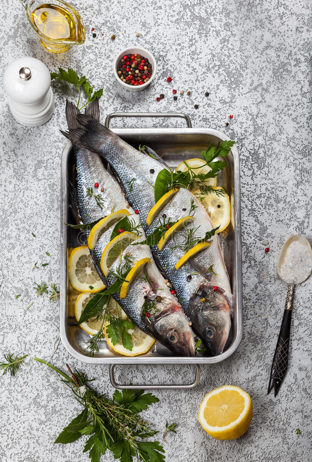 Sea bass before cooking. Sea bass with lemon,herbs and persian blue salt before cooking royalty free stock photo