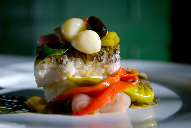 Sea bass dinner. Image of grilled sea bass with vegetables stock photos