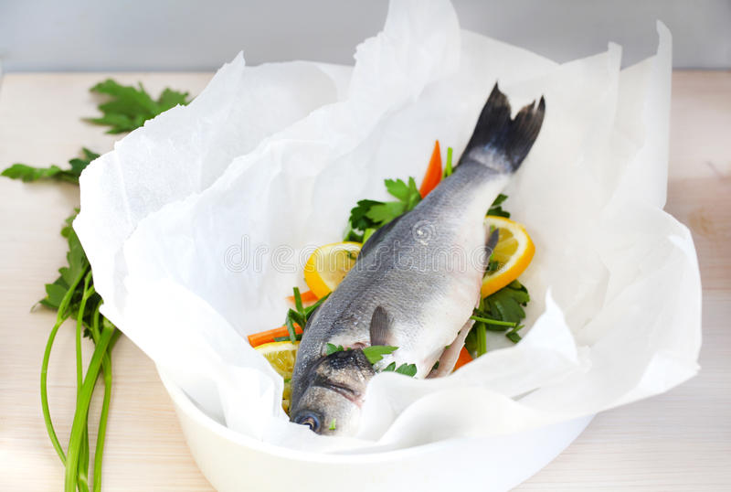Sea bass en papillote with vegetables royalty free stock photos