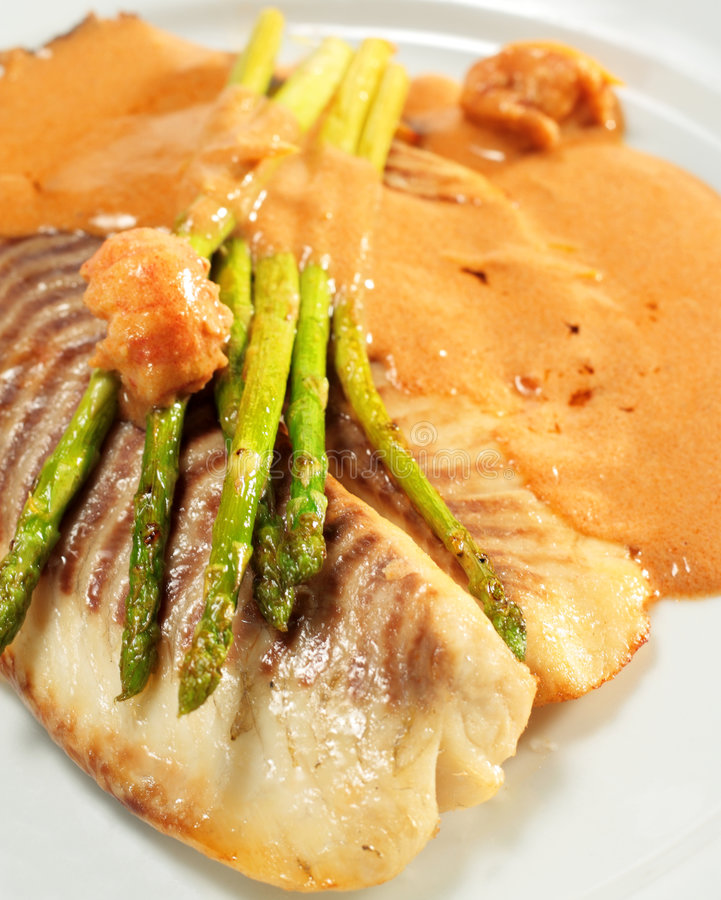 Sea Bass Fillet. With Tomato Sauce and Fresh Asparagus stock photo