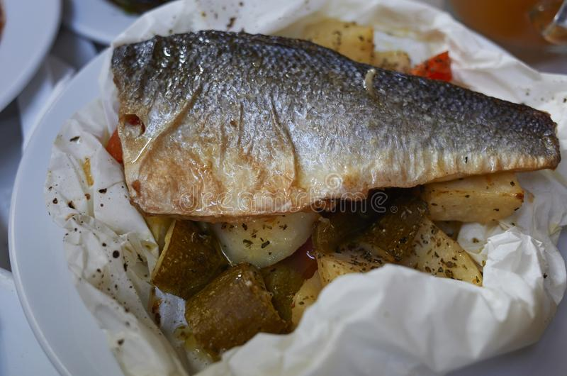 Sea bass fillet on a greek taverna stock photo