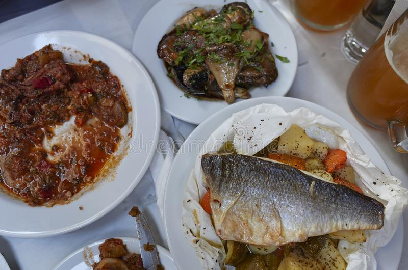 Sea bass fillet on a greek taverna royalty free stock images