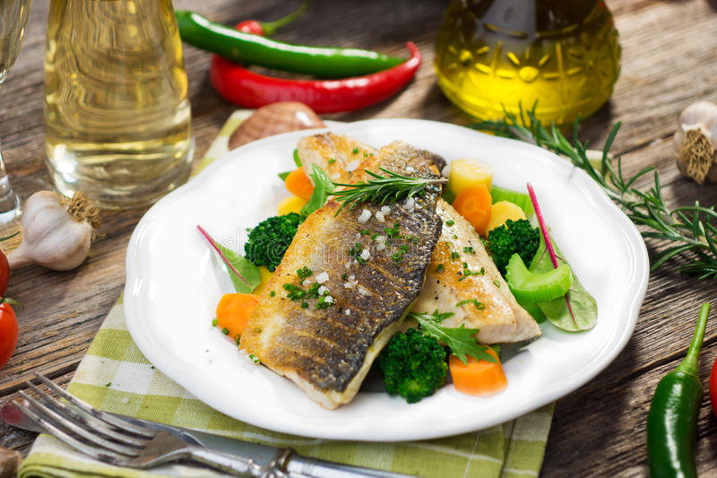 Sea bass fillet with vegetables royalty free stock image