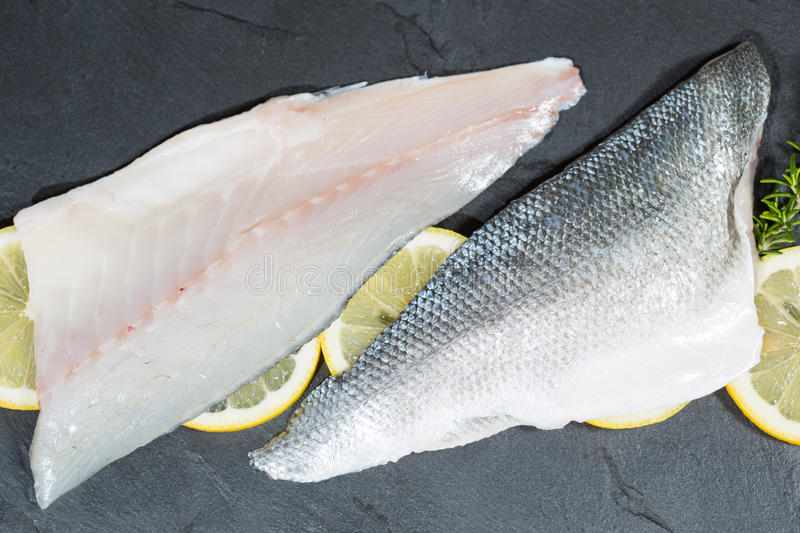 Sea bass fillets. Fresh sea bass fillets and cut and clean royalty free stock photography
