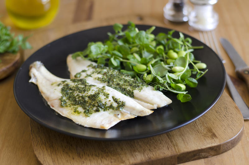 Sea bass fillets. With a rocket and pesto butter royalty free stock photography